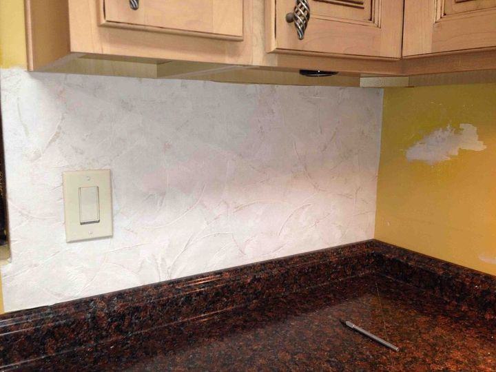 Filled in holes, smoothed walls. Applied plaster appearance wall paper that's paintable... Easy backsplash!