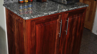 , Large 18 x 21 granite tiles look a lot like slab but at a much lower cost plus for me it is DIY