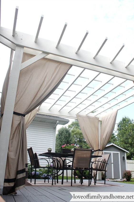 back deck makeover pergola reveal, decks, fireplaces mantels, outdoor furniture, outdoor living, painted furniture