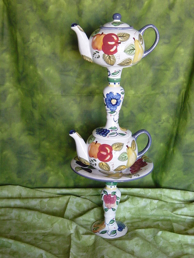 A teapot on a teapot totem.  The candlestick on the bottom will be placed over a stake in my yarden for stability. Glass redefined and assembled by Nita Hooper.