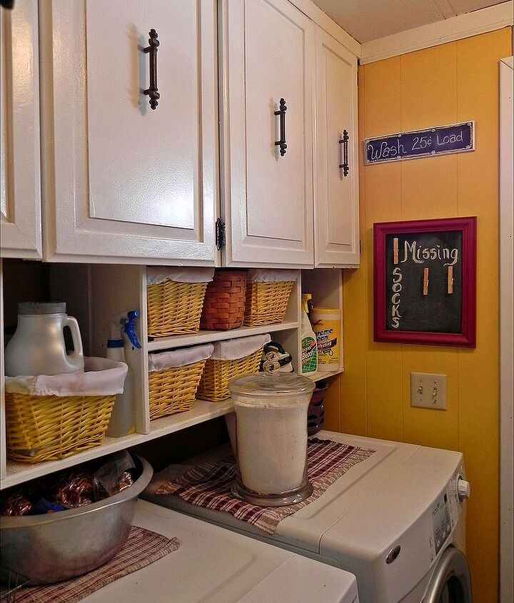 taking a bright color into the smallest laundry room turned it from a dark dismal corner to a fun place to do laundry....yeah right!