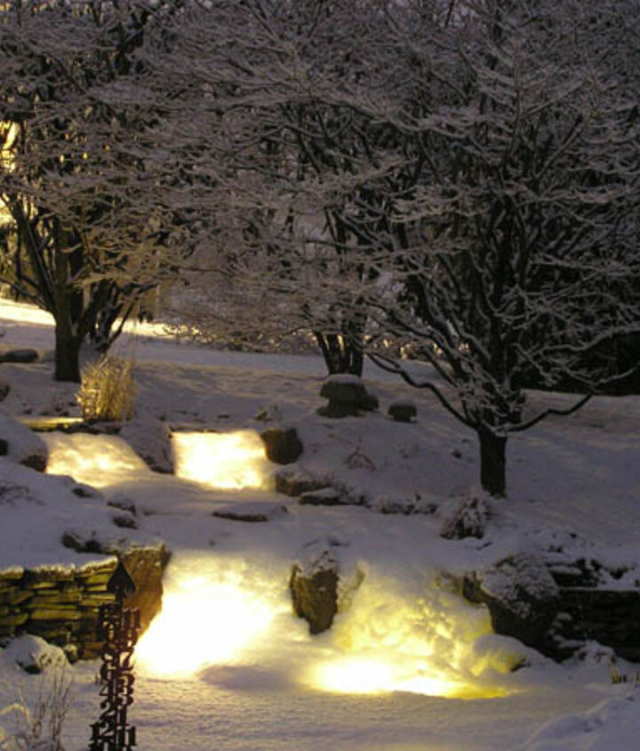 Snow has covered the waterfall lights creating a magical glow.