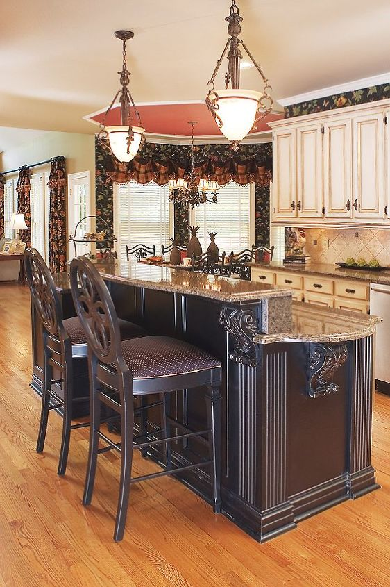 AK managed to keep nearly all of the existing perimeter cabinets by touching them up and adding an antique faux finish. The antiqued ebony island is what really set the kitchen apart and made for a dramatic change. http://bit.ly/SBx6Pq