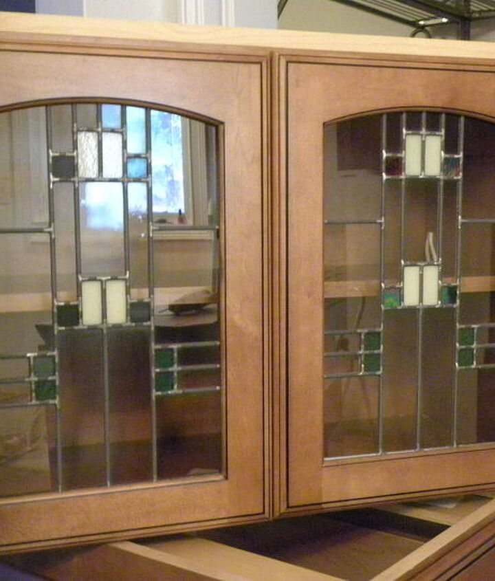 Glass doors on cabinet over the microwave & range.