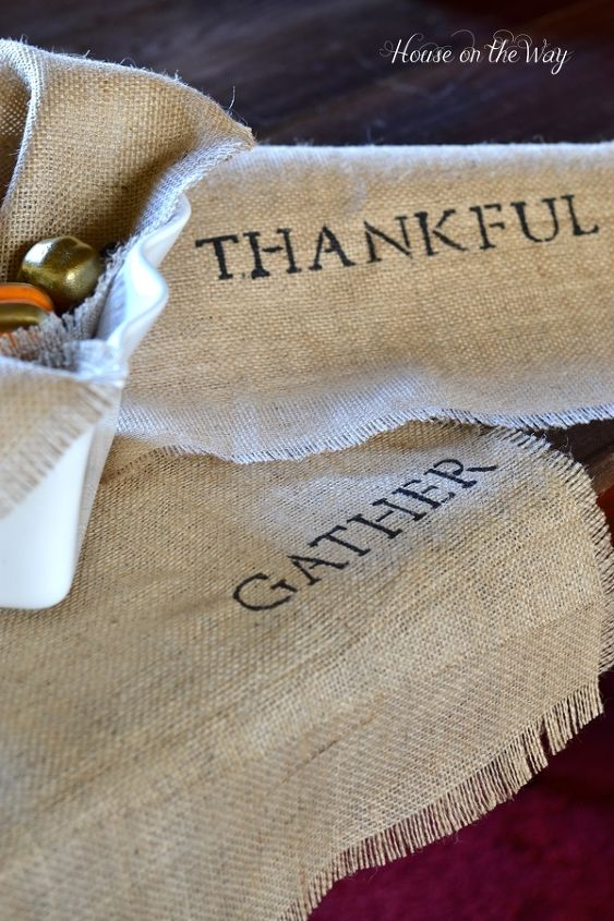 These burlap stenciled table runners are easy and make a great base for your table decor.