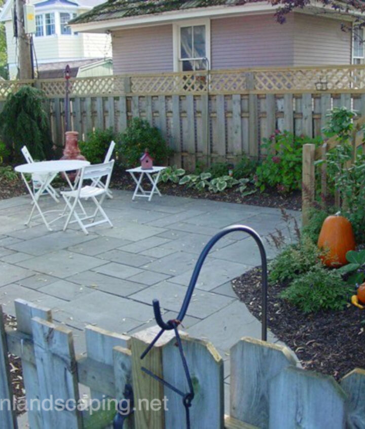 Backyard Bluestone Patio Installation, Landscape Design, Low Maintenance Plantings, Fence, Deck, Steps Redesign in Rochester NY by Acorn Landscaping: Certified Aquascape Contractors, Landscape Contractors, Designers of Rochester NY.