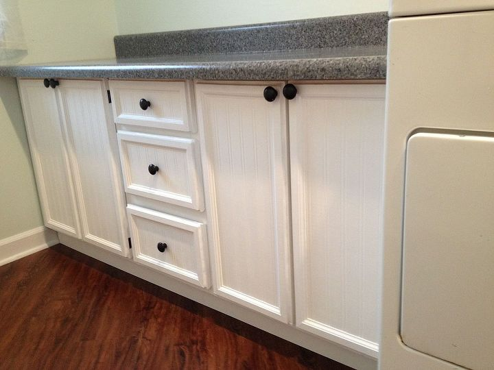 These used to be flat plank cabinets.  I put beadboard wallpaper, trim and caulk to make them match upper cabinets.  A couple coats of poly and new knobs, and they look new.