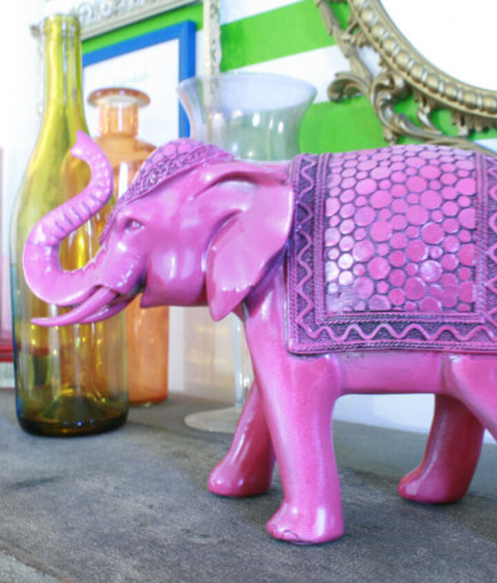 Elephant gets a coat of pink spray paint.