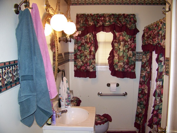 Even adding our curtains from the old house didn't help this bathroom...