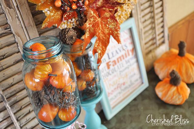 Pumpkin and pine cone filled mason jars