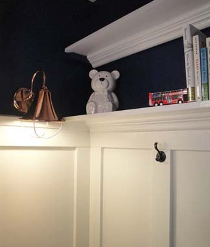 Sconce added by running a cord around the molding and plugging it into the outlet outside the closet.