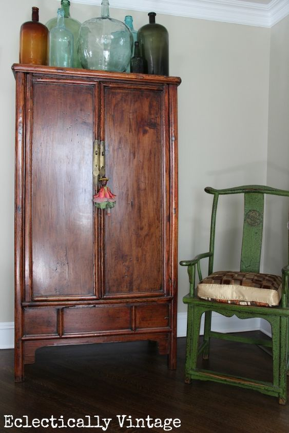 You'd never know the horror that lie within this armoire! http://eclecticallyvintage.com/2013/01/mission-organization/