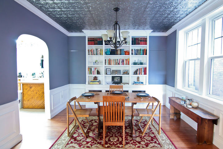 It's fun to see the transformation of the space, and how much the crown, wainscot panels, chair rail, and tin ceiling adds to it.  The 2 doors flanking the bookcase were built in to the wall design to conceal them.