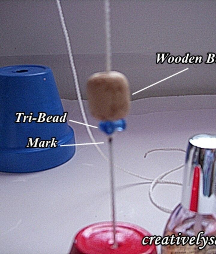 terra cotta wind chime, crafts, Use nylon cord tri beads wooden beads to space the 3 pots