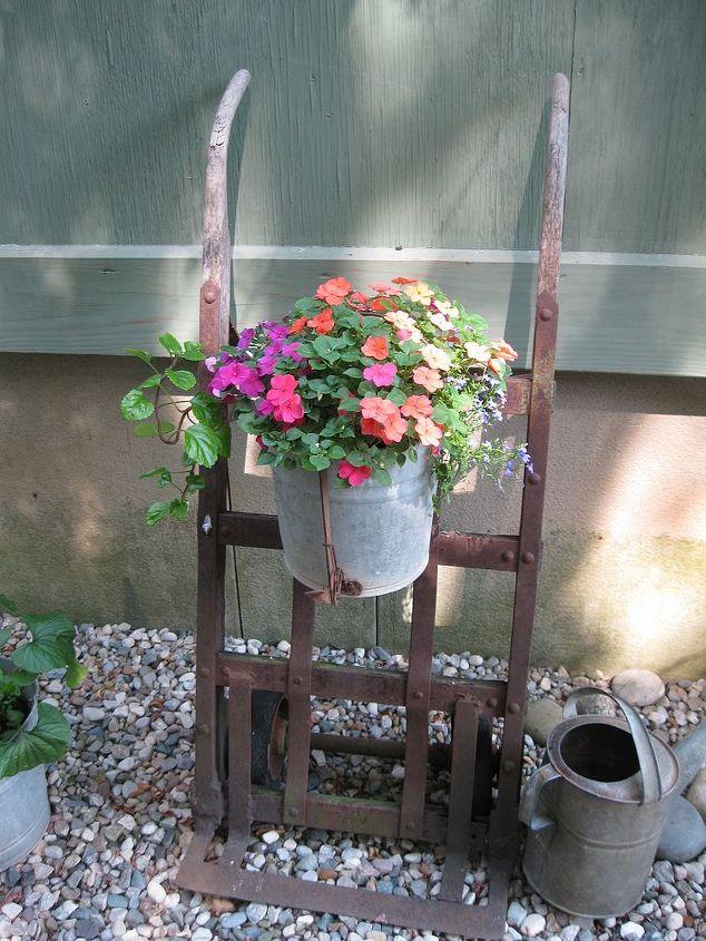 hand dolly flower pot holder, flowers, gardening, repurposing upcycling, Hand dolly flower pot holder