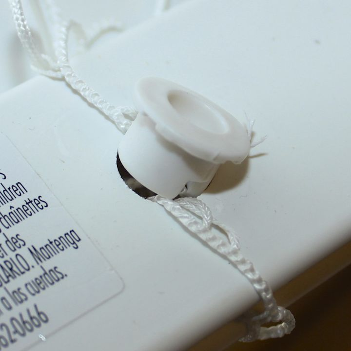 Tie the excess ladder strings together and stuff them in the hole. Replace the plug.
