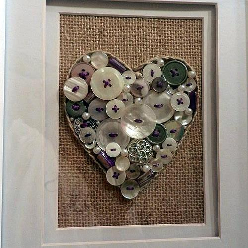 button art, crafts, repurposing upcycling, BUTTON ART ON BURLAP MUSLIN BACKGROUND THE HEART EDGE IS BRAIDED JUTE TWINE BUTTONS ARE ACCENTED WITH PURPLE EMBROIDERY FLOSS STITCHING WHITE AND SILVER BUTTONS PEARLS AND PURPLE STONES WERE GLUED ONTO THE BURLAP