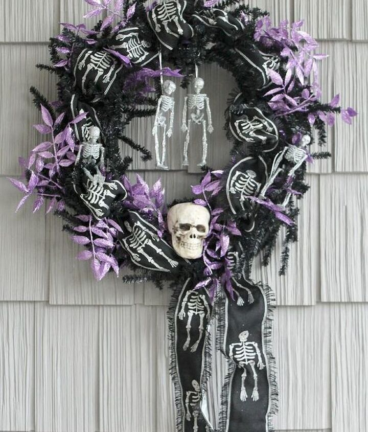 Spooky 'Til Death Do Us Part wreath decoared with skulls, skeleton ribbon, glitter skeletons and a pop of purple glittered leaves.