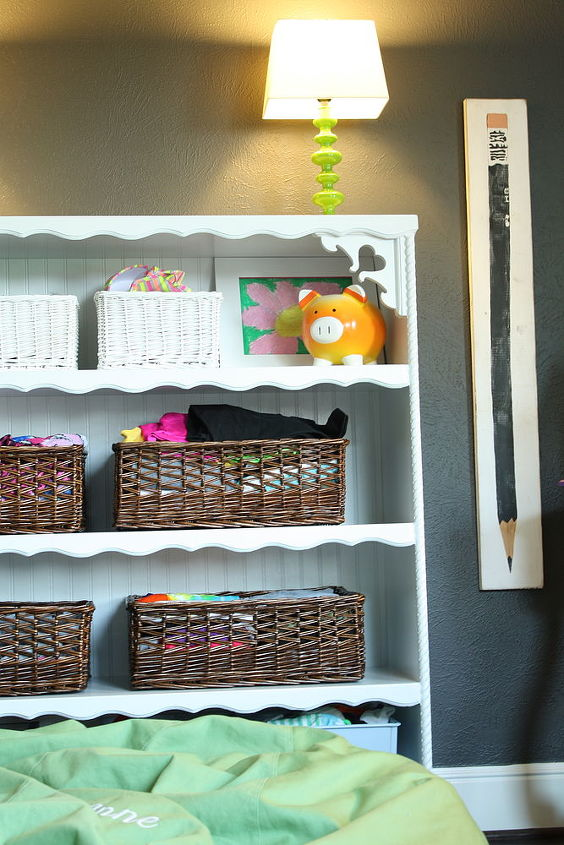 Baskets on her shelf instead of a traditional dresser.