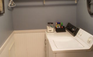 my 186 laundry room makeover, home decor, laundry rooms, organizing, After Soft blue gray color on the walls beadboard and trim new floor and black accessories and baskets to help with organization Much better