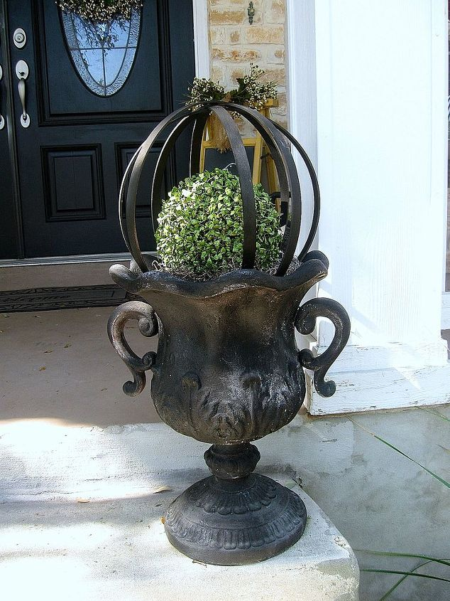 I added my faux boxwood orbs back on my urns after a new coat of green spray paint.