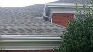 gutters around house cost, home maintenance repairs, roofing, Added a downspout and that moves water to next picture