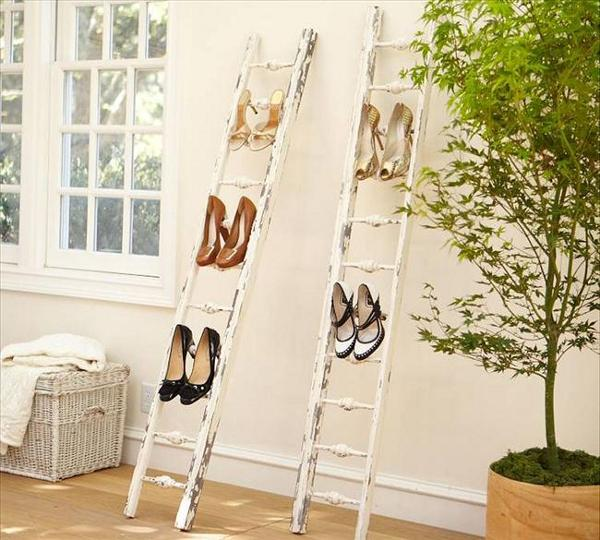 This is by far my favourite DIY ladder shelving idea. The ladder is turned into a funky shoe rack. If you love to surprise your guests, this is the way to reuse an old ladder!