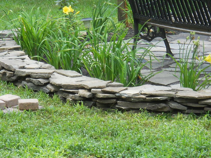 flagstone border wall, concrete masonry, gardening, Border wall