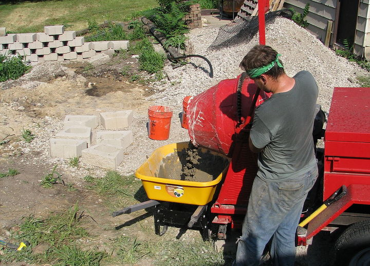 pouring concrete footers for basement support columns, basement ideas, concrete masonry, Concrete mixer hard at work
