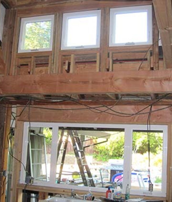 The 8' ceiling was removed and a dormer was added with 3 new south facing windows. We also enlarged the existing lower window to bring in as much natural light as possible.