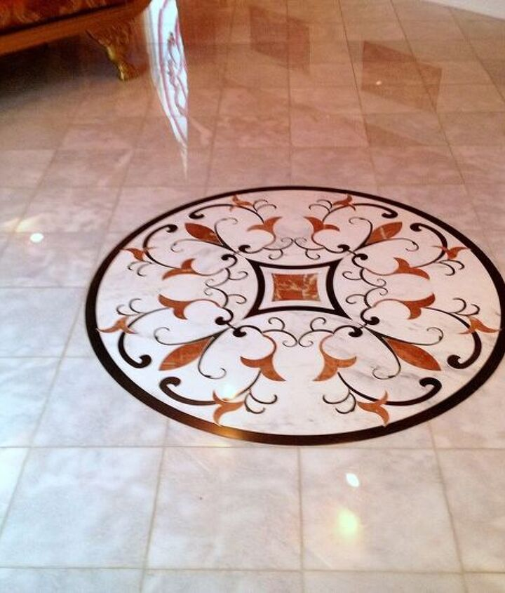 This is a client design, cut out of marble and installed in several areas of the home.