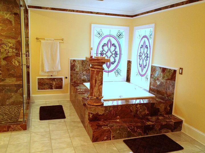 A bath fit for a king?  Note the tile edgeing along the top of the walls,