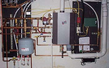 this is a photo of the recent boiler combi unit i installed, heating cooling, plumbing, NTI Combi boiler Top of the line Takes up a lot of wall space to install properly Boiler heat exchanger is only as around as a five gallon bucket and deep as about one half the height of that same bucket 110 lbs total