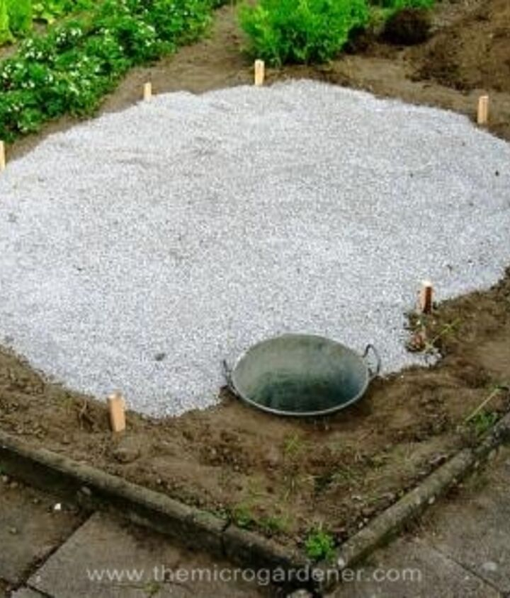 Gravel base laid & pond put into position. Ready to build the vertical herb spiral structure.
