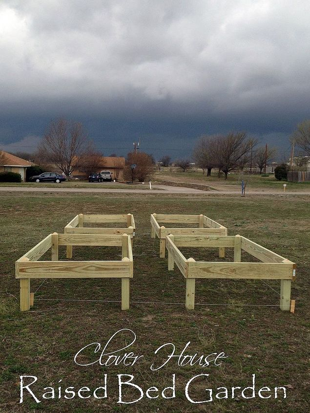 raised bed gardens part 1, diy, gardening, how to, raised garden beds, woodworking projects, Each bed was constructed with 2x8 treated lumber Here they are ready to be set in the ground