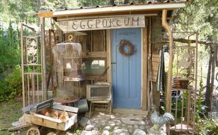 the eclectic eggporeum junk gardening at it s finest, gardening, outdoor living, Blue door lots of funky salvage to display in front what more could a junk gardener ask for