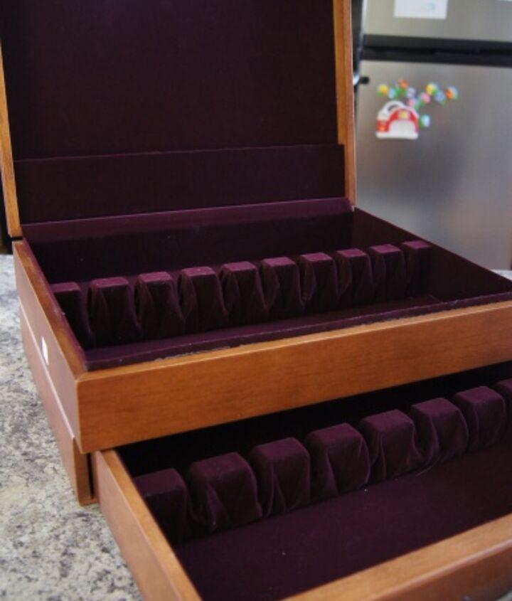 It used to house flatware. Mmmm purple velvet...