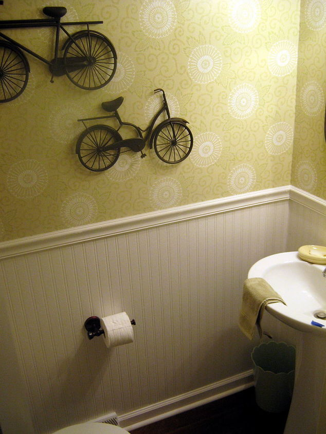 The iron bikes are from Hobby Lobby.  We chose oil-rubbed bronze fixtures and art for contrast.  Plus it ties in with the dark wood floors.