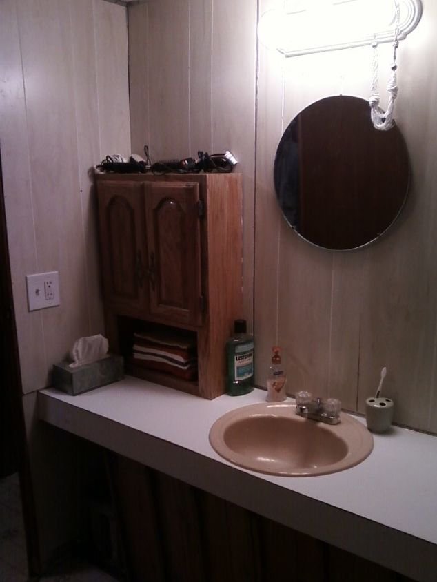 Before: 6' countertop with no storage underneath because of a heating duct.  One rusted out sink in the middle