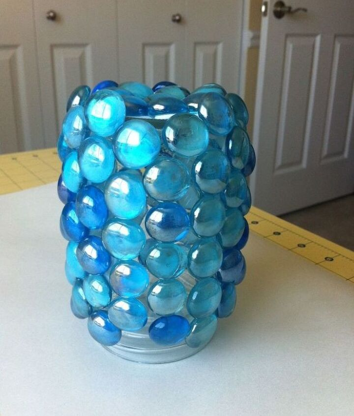 I glued the marbles all over the jar in a random pattern.
