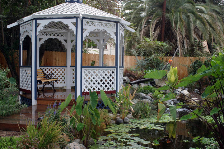 A cottage style gazebo provides great seating by the pond.