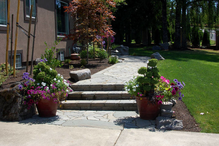 New front walkway. Boulders and bluestone slate elevate this paver install. By Ross NW Watergardens in Portland, OR.
