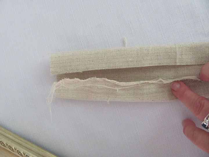 Cut your fabric of choice to about 6 inches wide. I just rip it down. It's faster.  Fold fabric in on both sides as picture shows so that the raw edge of the fabric is inside and underneath.