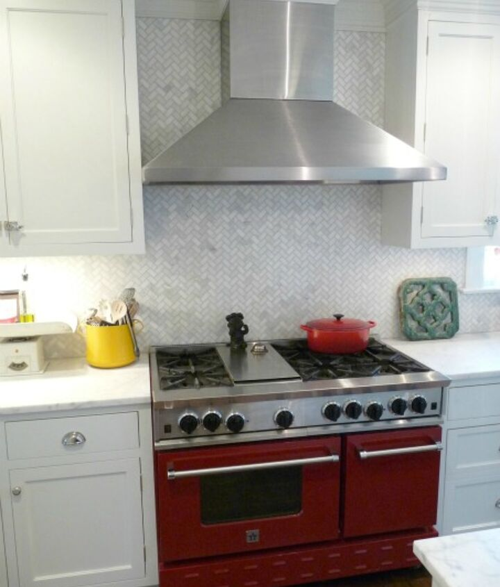 A red stove for a modern touch but the stove/oven combo is old style. See entire kitchen here:  http://eclecticallyvintage.com/2012/02/kitchen-tour-renovation-white/