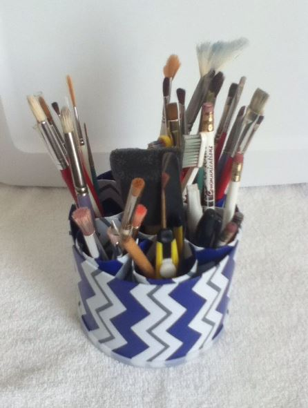 Ok now you can fill the container with whatever you want, make-up, pens & pencils or paint brushes like I did.