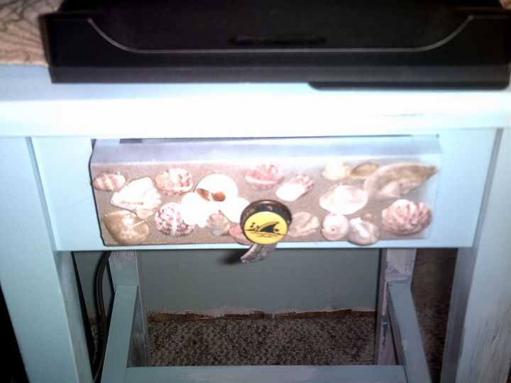 painted and painted the drawer with sand texture paint, glued on shells, and a bottle cap from Land Shark beer bottle on the knob.