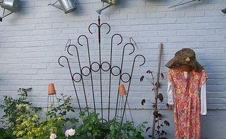 garden display ladder, gardening, repurposing upcycling, Create a hanging display for birdhouses and watering cans from a repurposed ladder See more of my ideas and projects at and