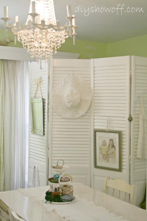 bifold closet doors act as a folding/dressing screen