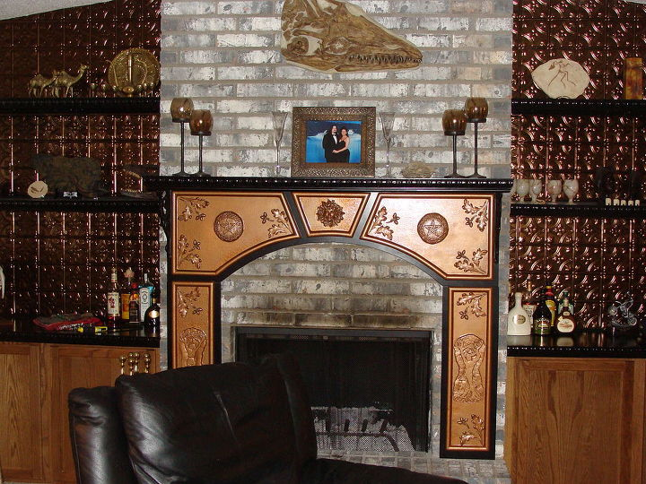 And PYOW!!!! What a BIG DIFFERENCE!! He even custom built the mantle for me. The copper on the walls is that sheeting that you use for a backsplash in most kitchens. We felt like it made a dramatic statement.
