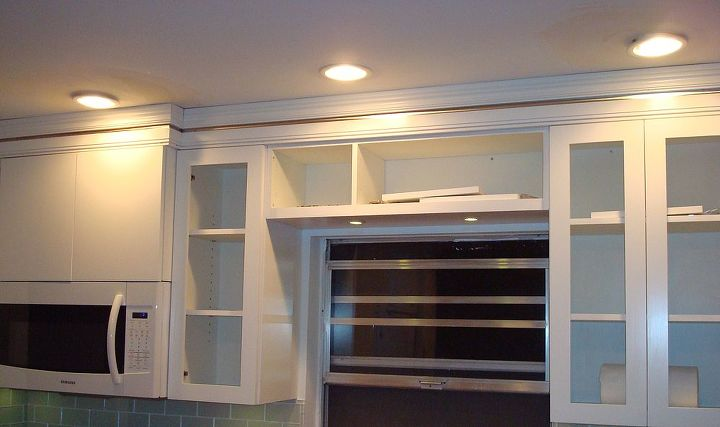 I requested our cabinet maker insert a strip of stainless steel into the crown moulding.